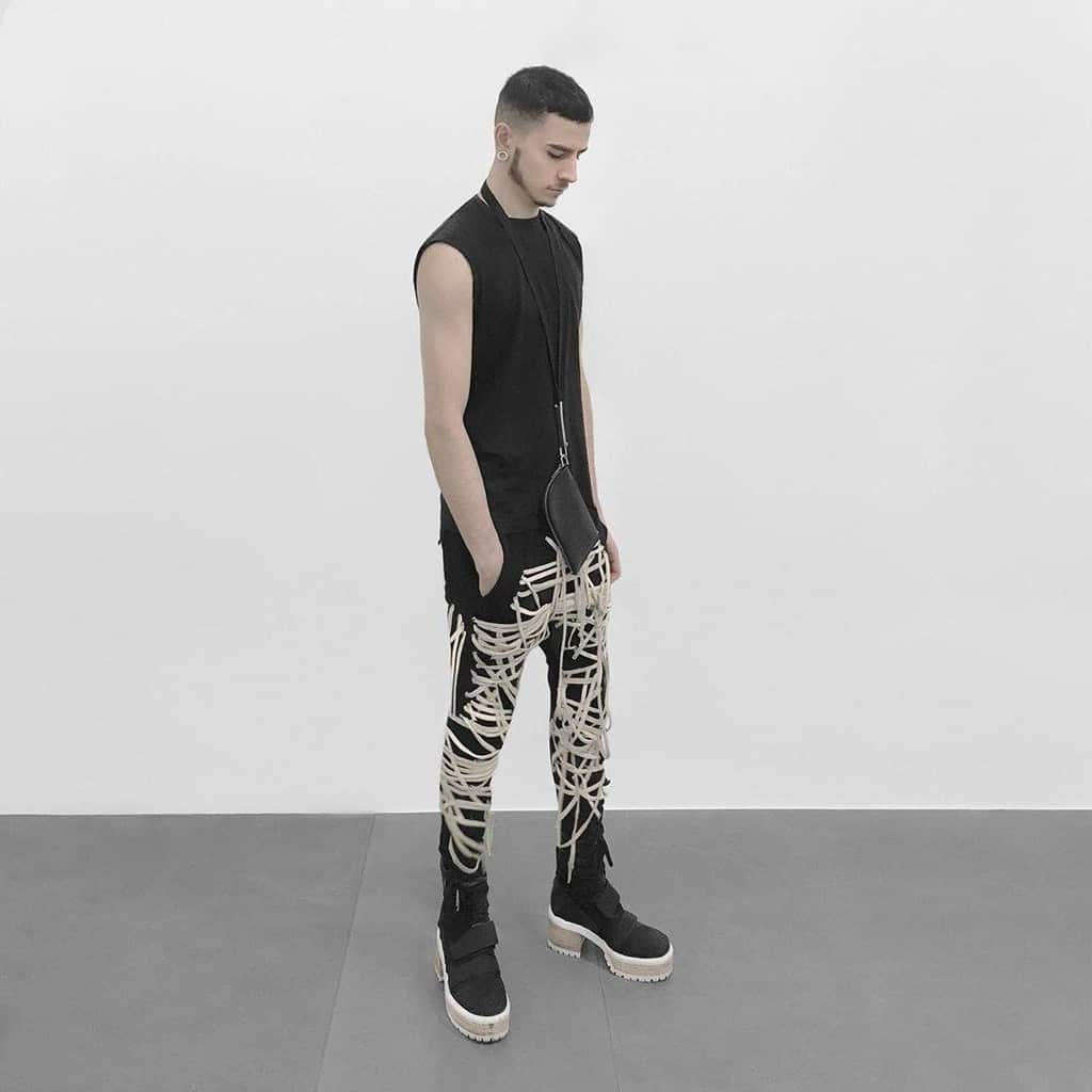 futuristic fashion for men tank top unique pants and wooden sole boots
