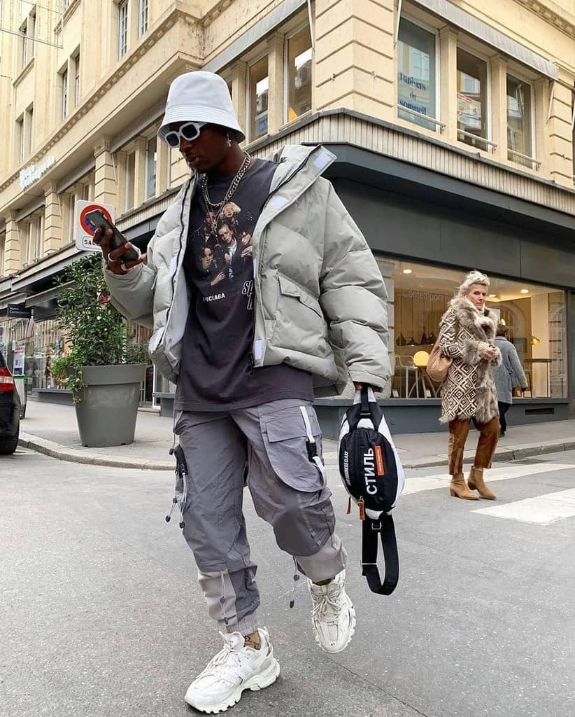 futuristic fashion for men white puffer jacket pair with gray jogger pants
