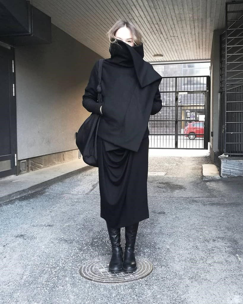 all black, face covered, mysterious outfit paired with black leather boots