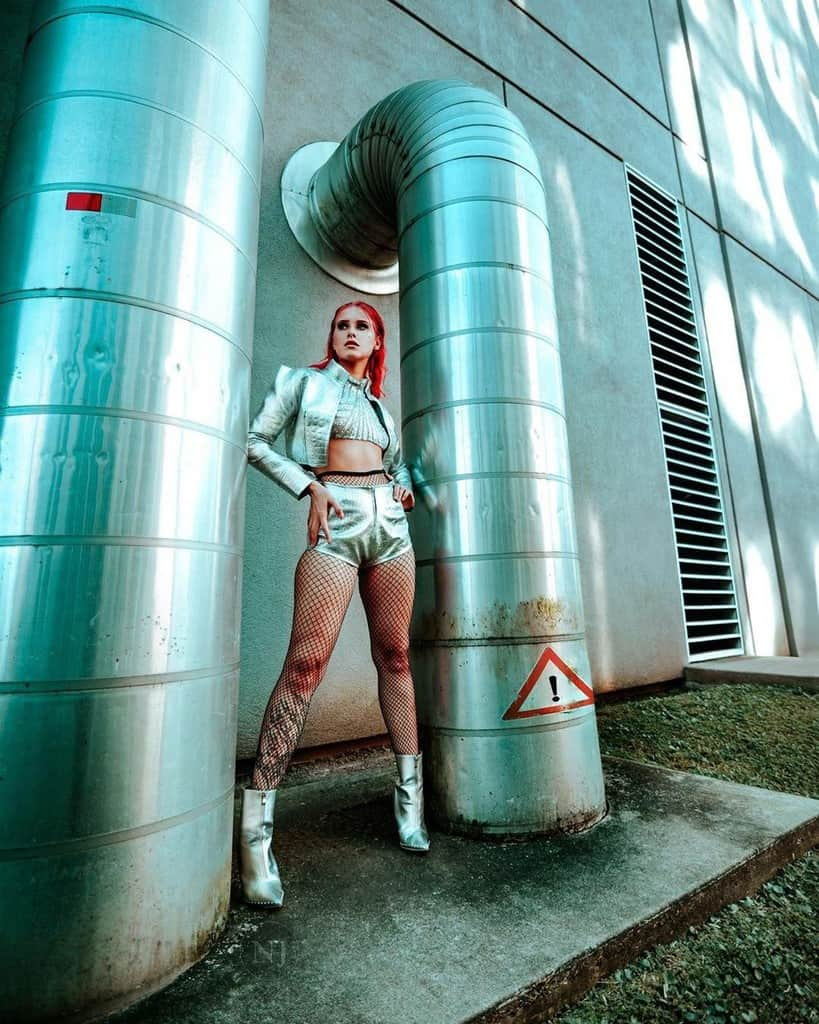futuristic fashion silver metallic pair of jacket and short with fishnet stockings
