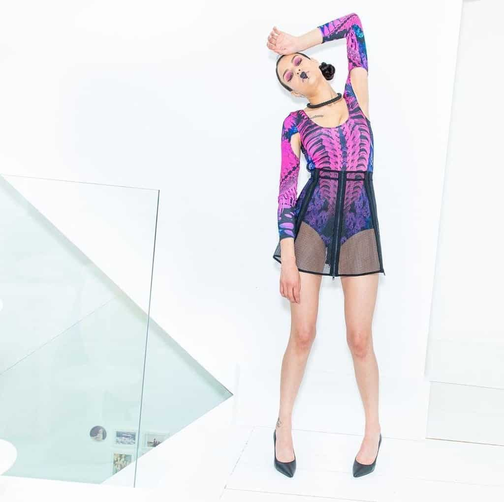 futuristic fashion with colorful leotard and see through skirt