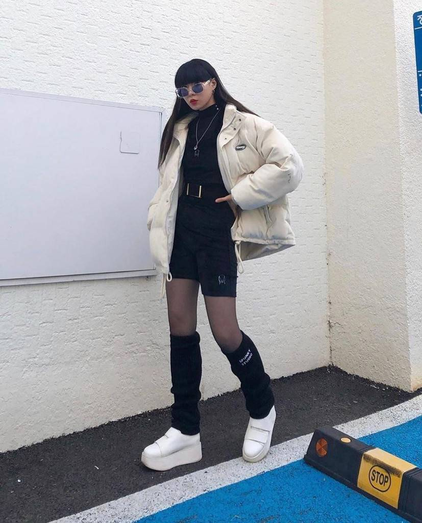futuristic fashion with white puffer jacket and knee high socks