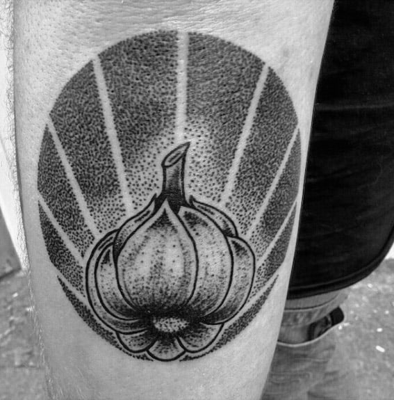Garlic Tattoo On Man