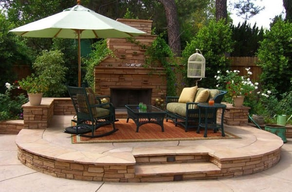 gas outdoor fireplace with black seating