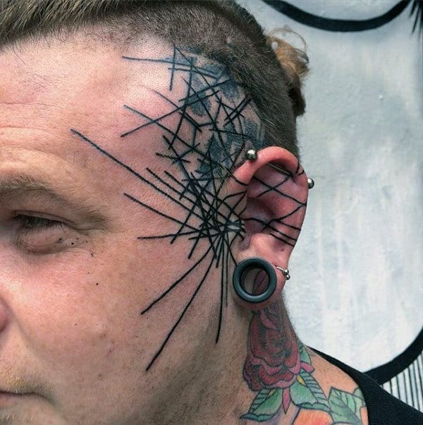 Gentleman With Abstract Black Ink Lines Face Tattoo