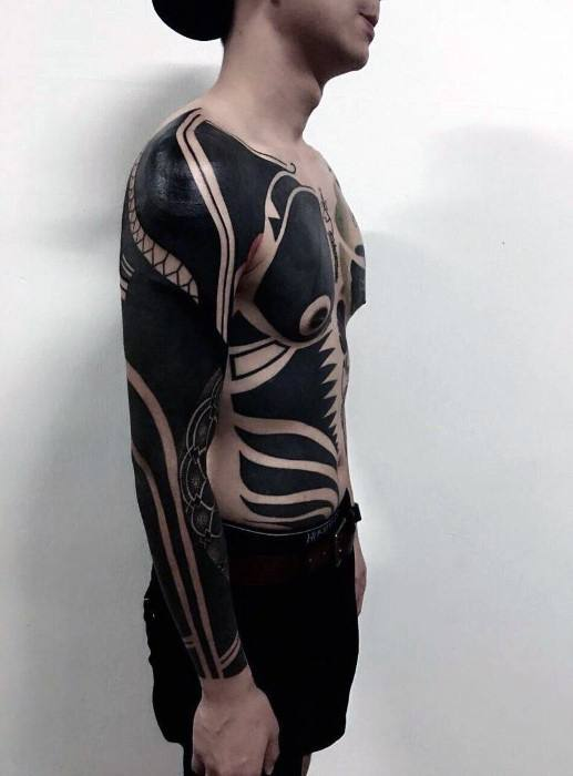 a3d6fc0b9 Gentleman With All Black Ink Chest And Sleeve Tattoo Designs