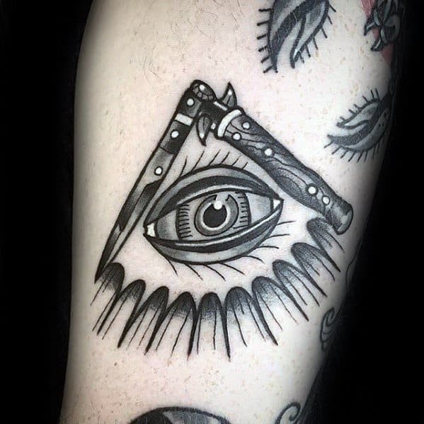 Gentleman With All Seeing Eye Switchblade Tattoo On Arm