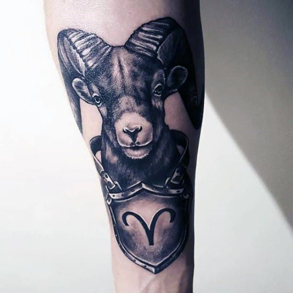 Gentleman With Aries Ram And Shield Tattoo On Inner Forearm