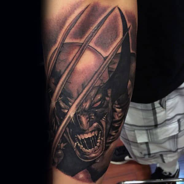 Gentleman With Arm Tattoo Of Shaded Wolverine Design