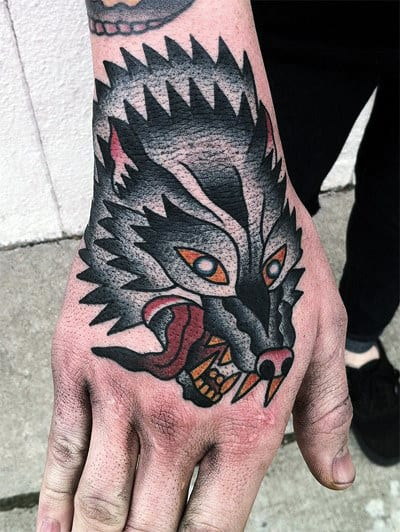 Gentleman With Awesome Traditional Wolf Hand Tattoo