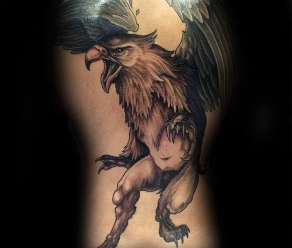 Gentleman With Back Tattoo Of Griffin