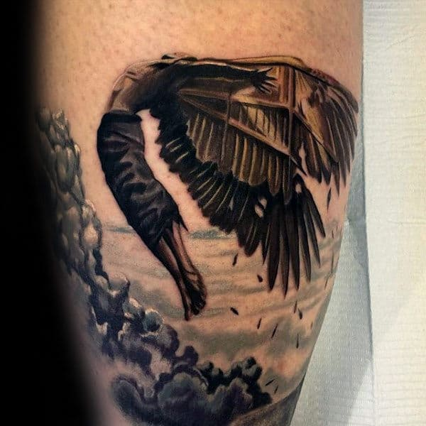 Gentleman With Black Icarus In Clouds Arm Tattoo