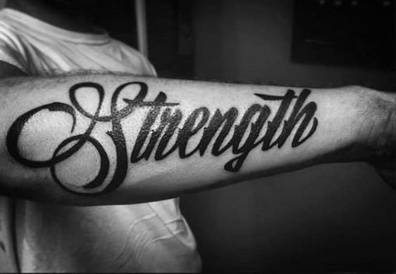 Gentleman With Black Ink Strength Word Tattoo On Outer Forearms