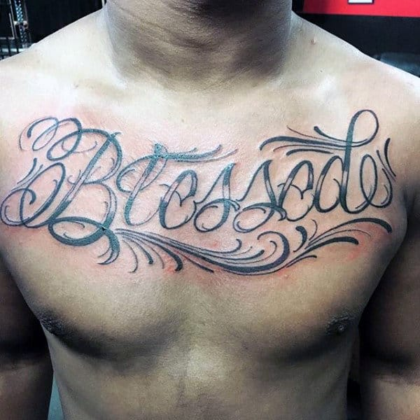 Gentleman With Blessed Lettering Script Tattoo On Upper Chest