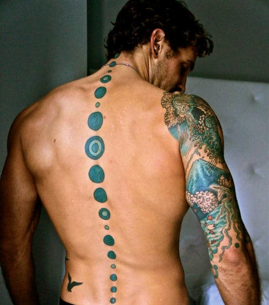 Gentleman With Blue Dot Spine Tattoo