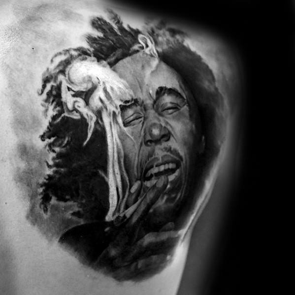 Gentleman With Bob Marley Shoulder Blade Tattoo