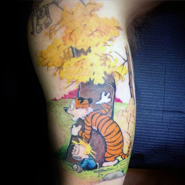 Gentleman With Calvin And Hobbes Behind Tree Tattoo On Arm