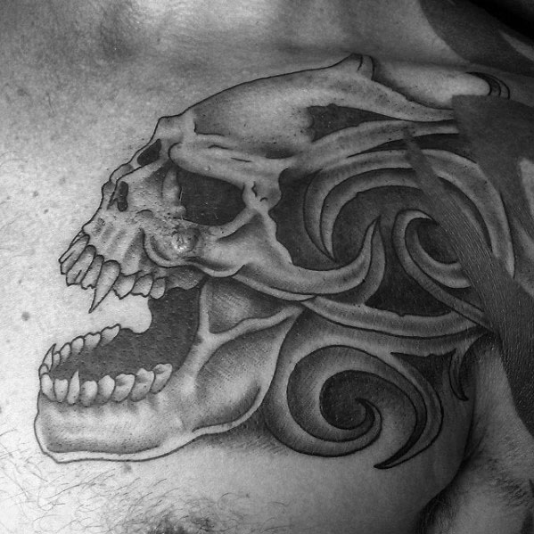 Gentleman With Chest Tribal Skull Tattoo