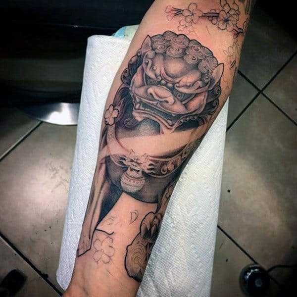 Gentleman With Cool Foo Dog Forearm Tattoo Design