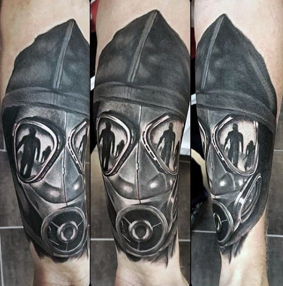 Gentleman With Creative Gas Mask Tattoo On His Wrist