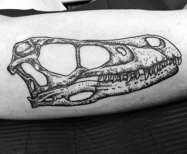 Gentleman With Detailed Velociraptor Skull Arm Tattoo
