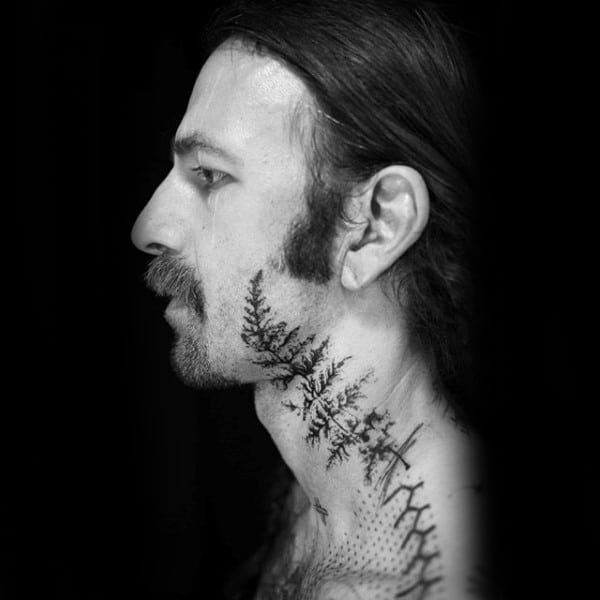 Gentleman With Fern Neck And Face Tattoo Abstract