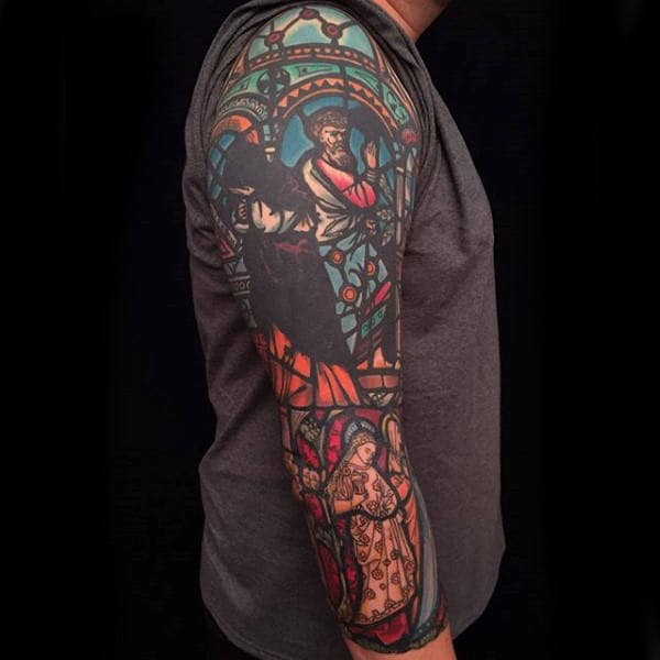 Gentleman With Full Arm Sleeve Tattoo Of Stained Glass Window Design