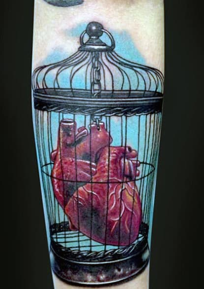 Gentleman With Heart In Cage Tattoo Traditional Style On Forearm