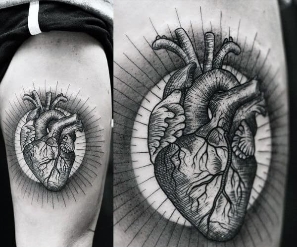 Gentleman With Heart Tattoo In Black Ink On Thigh Surrounded By Halo