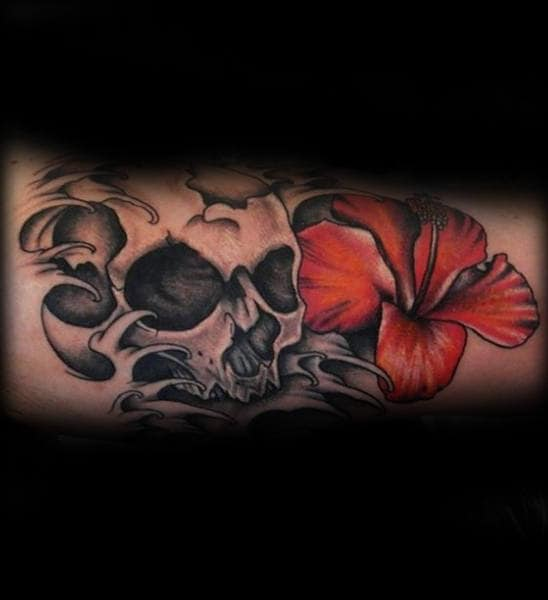 Gentleman With Hibiscus Flower And Skull Tattoo On Inner Arm