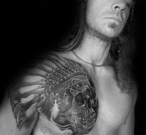 Gentleman With Indian Skull Tattoo On Upper Chest