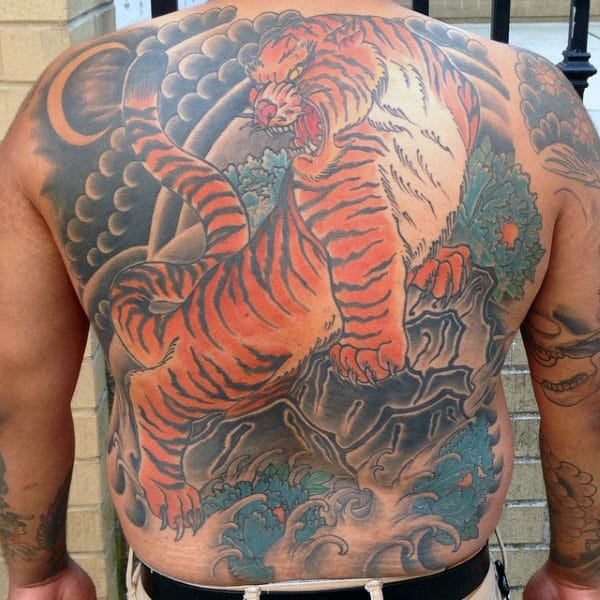 Gentleman With Japanese Tiger Standing On Rock Back Tattoo