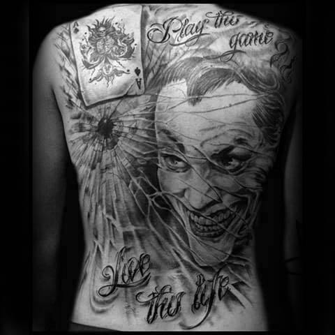 Gentleman With Joker Card Broken Glass Tattoo On Back