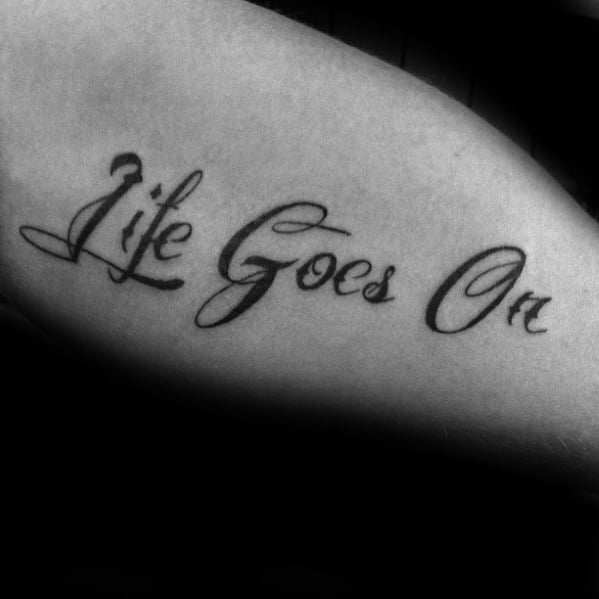 Gentleman With Life Goes On Tattoo On Arm