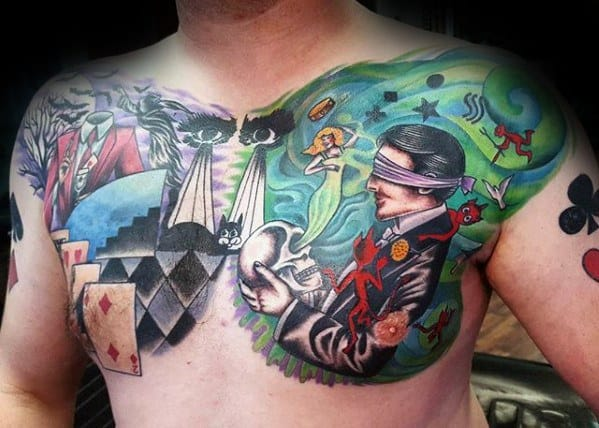 Gentleman With Magician Themed Upper Chest Tattoo