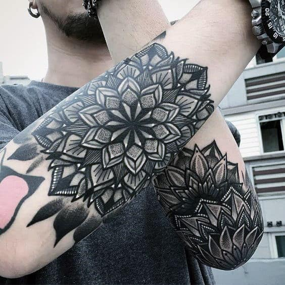Gentleman With Mandala Tattoos On Outer Forearms