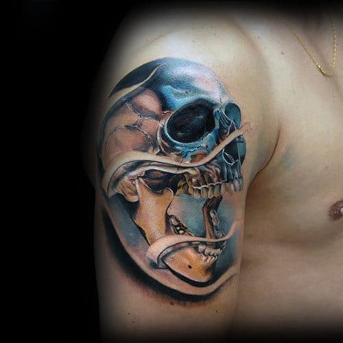 Gentleman With Metallic Realistic Skull Tattoo On Arm