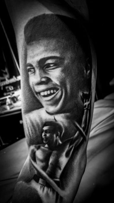 Gentleman With Muhammad Ali Tattoo On Arm