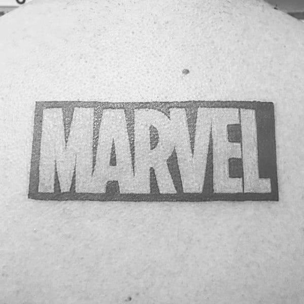 Gentleman With Negative Space Marvel Logo Upper Back Tattoo