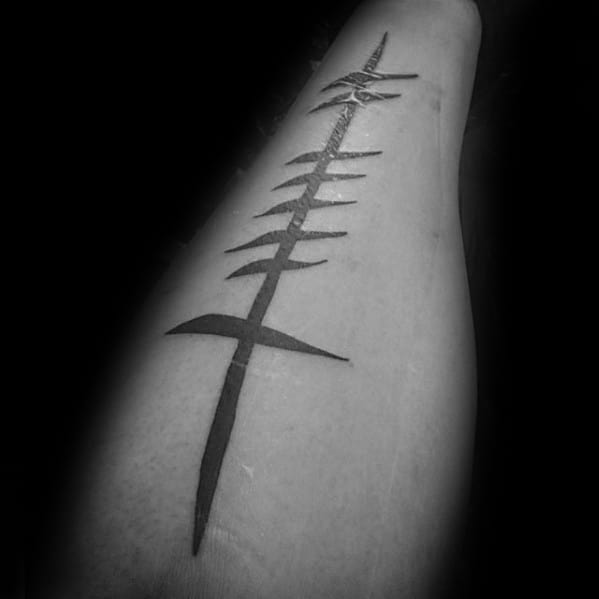 Gentleman With Ogham Tattoo On Inner Forearm