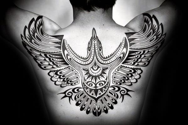 Gentleman With Ornate Tribal Bird Back Tattoo
