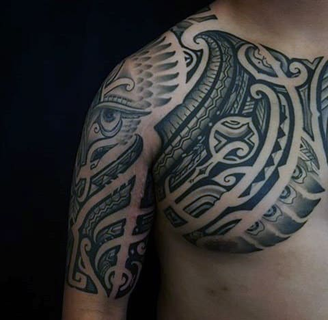 Gentleman With Polynesian Chest And Arm Tattoo