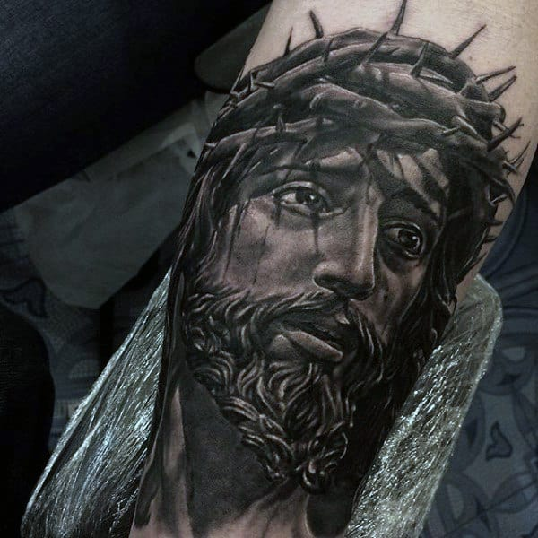 Gentleman With Realistic Jesus Portrait Arm Tattoo