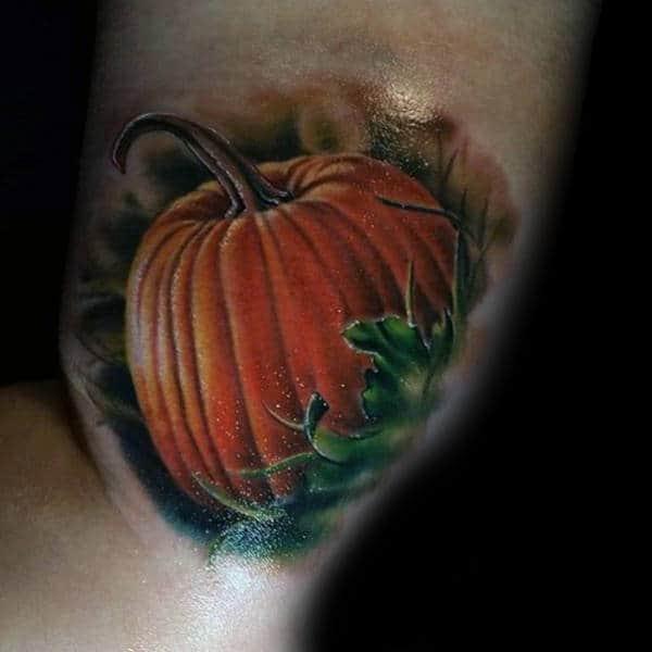 Gentleman With Realistic Pumpkin Arm Tattoo