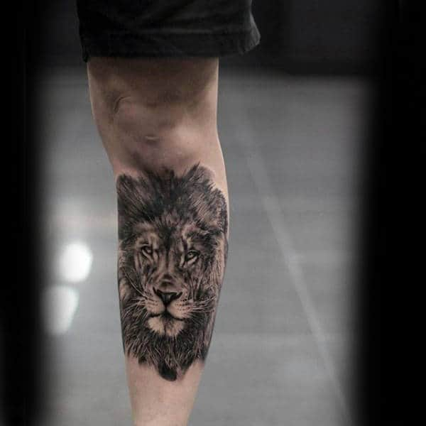 Gentleman With Realistic Shin Tattoo Of Lion