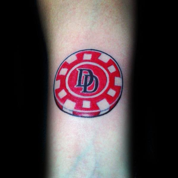 Gentleman With Red And White Ink Poker Chip Tattoo On Wrist