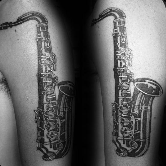 Gentleman With Saxophone Arm Tattoo