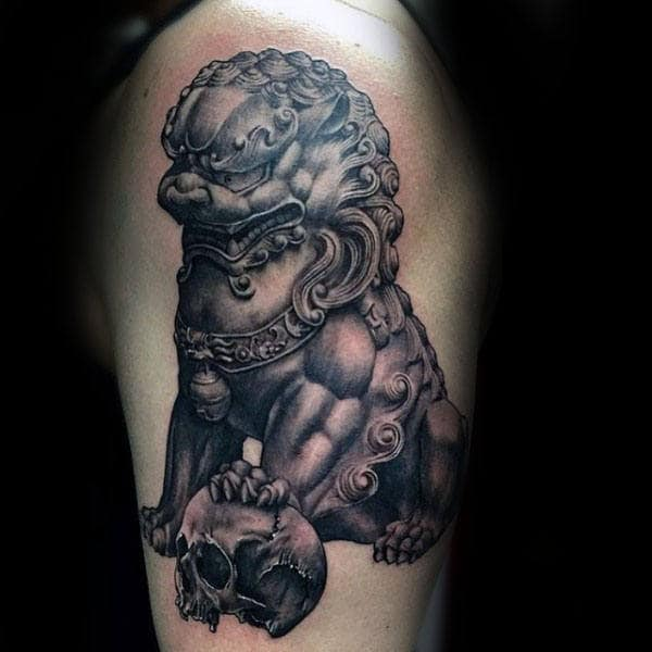 Gentleman With Shaded Foo Dog Statue And Skull Tattoo On Arm