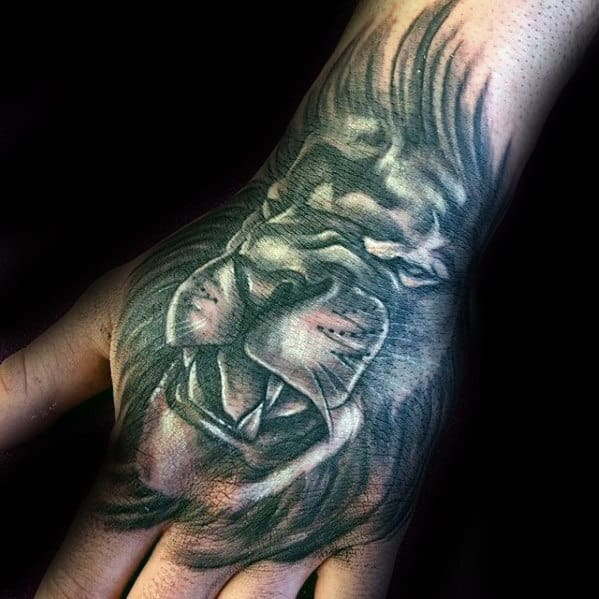 Gentleman With Shaded Grey And Black Hand Tattoo With Lion Design