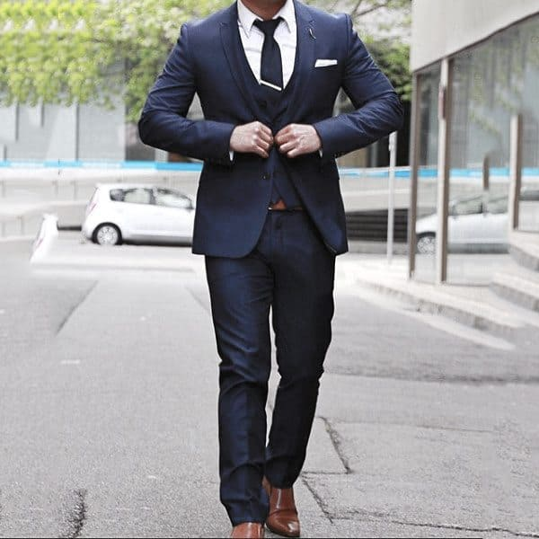 Gentleman With Sharp Navy Blue Suit Style With Brown Dress Shoes And White Pocket Square